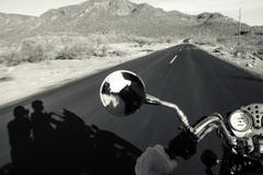 Couple of motorcyclists on the road - stock photo