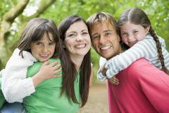 Family outdoors smiling Stock Photos