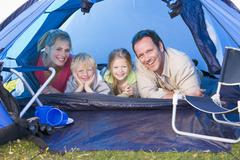 Family camping in tent smiling Stock Photos