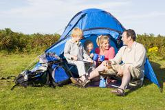 Family camping with tent and cooking Stock Photos