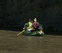 Family on river raft in rocky canyon Stock Footage