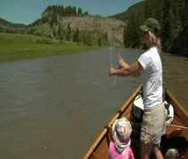 Woman flyfishing from driftboat on river 4 - stock footage