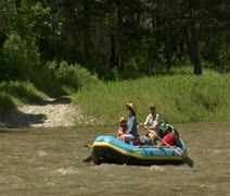 Family paddles raft on swift river Stock Footage