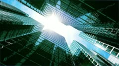 Camera turning at skyscrapers looking at the sun. Looped animation. HD 1080. Stock Footage