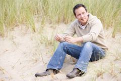 Man sitting on beach Stock Photos