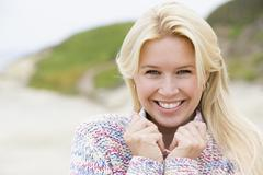 Woman standing at beach smiling Stock Photos