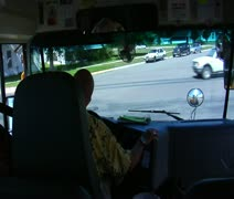 Shot of schoolbus stopped and then turning Stock Footage