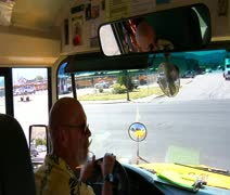 Shot of schoolbus driver looking and turning Stock Footage