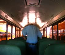 Shot of man walking through empty schoolbus Stock Footage