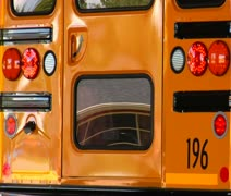 Shot of reflections in rear of parked schoolbus Stock Footage