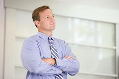 Stock Photo of Businessman standing indoors
