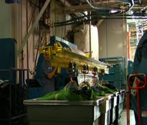 Large green bags being lifted by hydraulics Stock Footage
