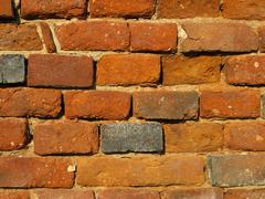 Weathered brick wall texture - stock photo