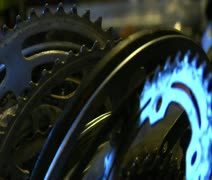 Metal bike parts gleaming in light - stock footage