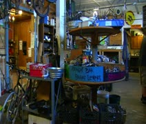 Bike repair shop with dog, slow motion Stock Footage