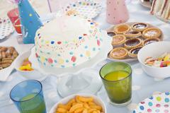 Birthday party table setting with food Stock Photos