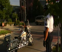 Policeman straddles motorcycle in slow-motion Stock Footage