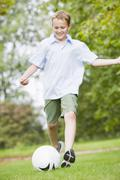Young boy playing soccer - stock photo