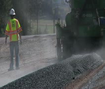 Road paving crew works with machines on highway Stock Footage
