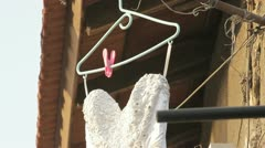 789. wedding dress hanged on a hanger in the flea market Stock Footage