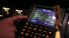 Pilot working on FMS computer Stock Footage