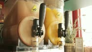Stock Video Footage of 792. two moist juice machines contatining ice coffee and orange juice