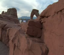 Steadicam shot of two ladies at delicate arch Arches national Park Stock Footage