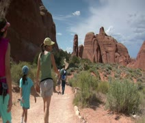 Family hiking in Arches national Park Utah Stock Footage