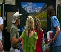 People admire painting at arts Festival Stock Footage