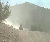 A series of four wheelers on dusty roads Stock Footage