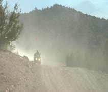 Four wheeler with headlights on dusty road Stock Footage