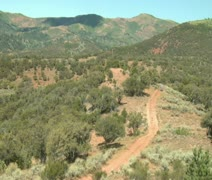 Wide shot of desert and ATVs on dirt road Stock Footage