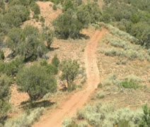 Long line of ATV riders on dirt road Stock Footage