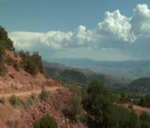 Redrock desert and mountain vista with ATV riders - stock footage