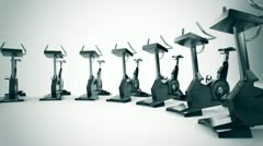 Gym equipment stationary bikes. - stock footage