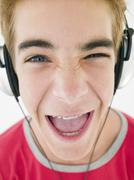 Teenage boy wearing headphones and smiling Stock Photos