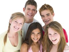 Five friends together smiling - stock photo