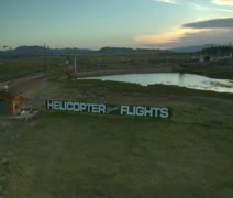 Aerial shot of scenic helicopter flights sign Stock Footage