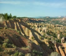 Extreme red rock vistas panning to ATV trails Stock Footage