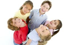 Circle of five young friends smiling Stock Photos