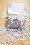 An Overflowing Paper Shredder - stock photo