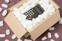 A Package Containing A Calculator Stock Photos