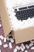 A Package Containing A Computer Keyboard Stock Photos