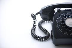 Studio Shot Of A Black Rotary Phone - stock photo