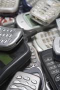 Pile Of Used Mobile Phones Stock Photos