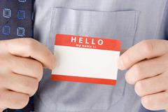 Close Up Of Businessman Attaching Name Tag Stock Photos