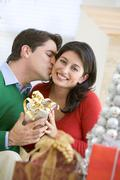Husband Surprising Wife With Christmas Present - stock photo