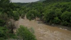 Muddy and swollen mountain river Stock Footage