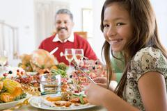 Grandfather And Granddaughter Sitting Down For Christmas Dinner Stock Photos