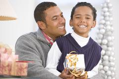 Father And Son Hugging,Holding Christmas Gift - stock photo